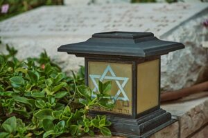brown and black wooden candle holder with star of david