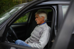 man sitting in a car after test drive